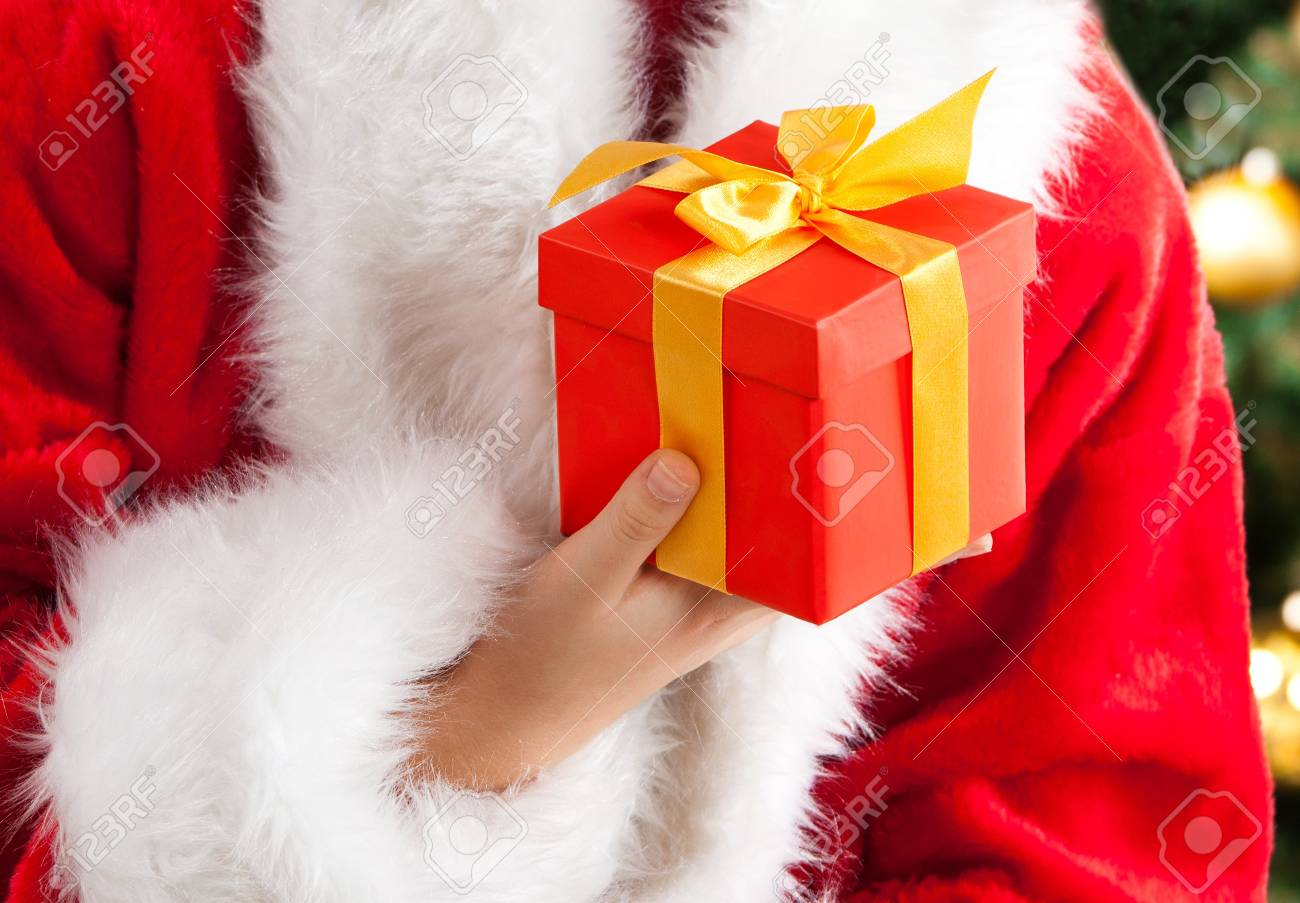 Red gift box with gold ribbon  Focus on the gift Stock Photo - 16613823