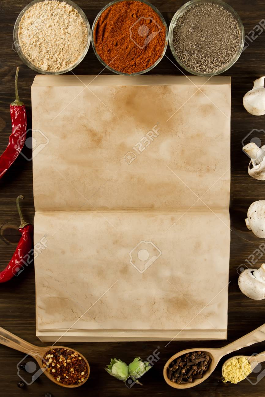 Open old vintage book with spices on wooden background healthy open old vintage book with spices on wooden background healthy vegetarian food recipe forumfinder Choice Image