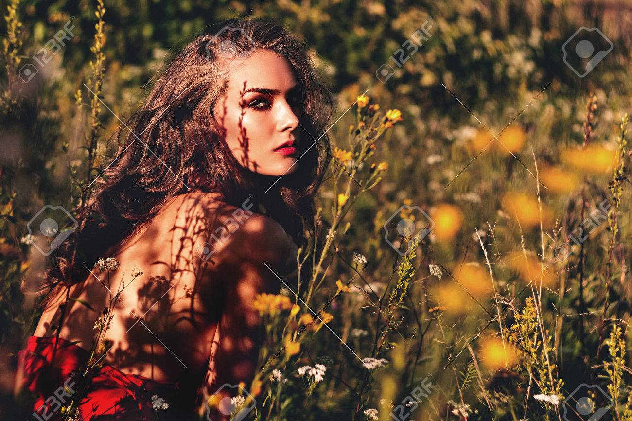 Woman In The Garden. Girl Flowers Landscape. Stock Photo, Picture ...