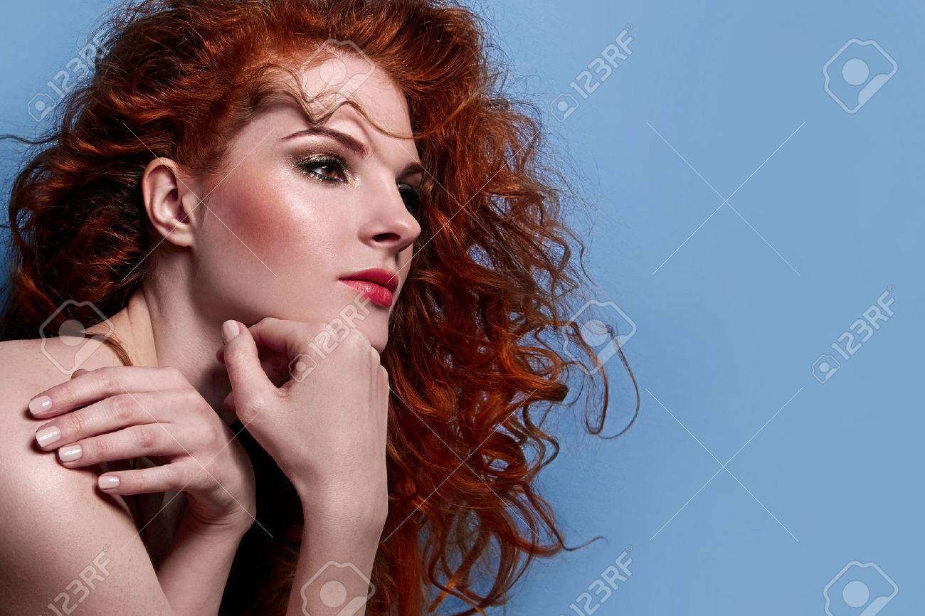 beautiful red-haired cute girl with curly hair, in profile view