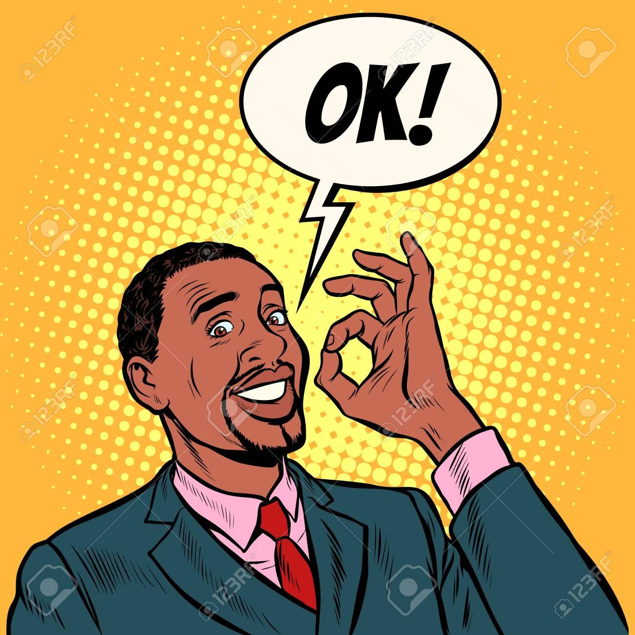 OK african man businessman. hand gesture okay. success good. Pop art retro vector illustration vintage kitsch 50s 60s - 124011159