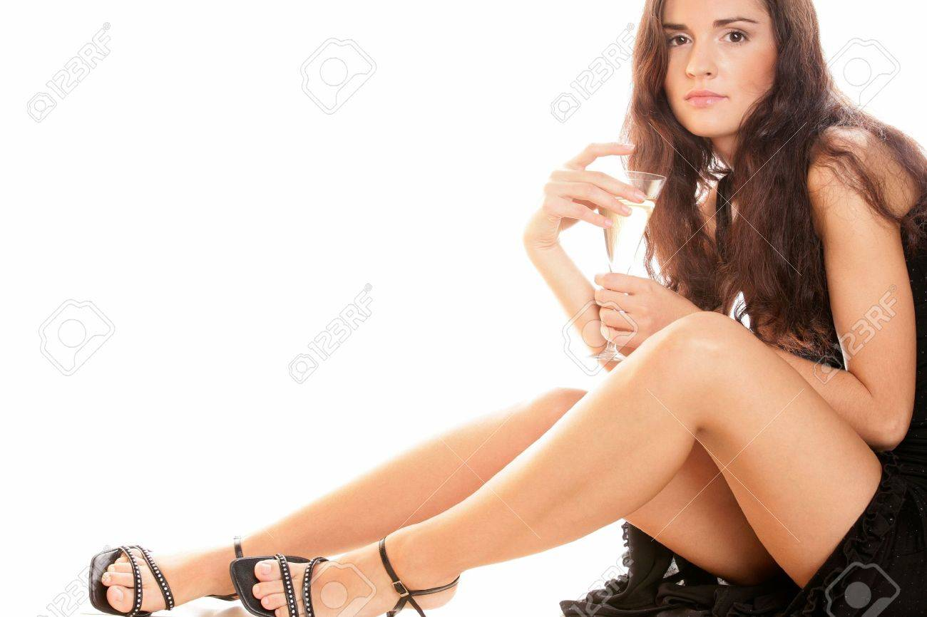 Beauty woman sitting with glass of champagne Stock Photo - 6545442