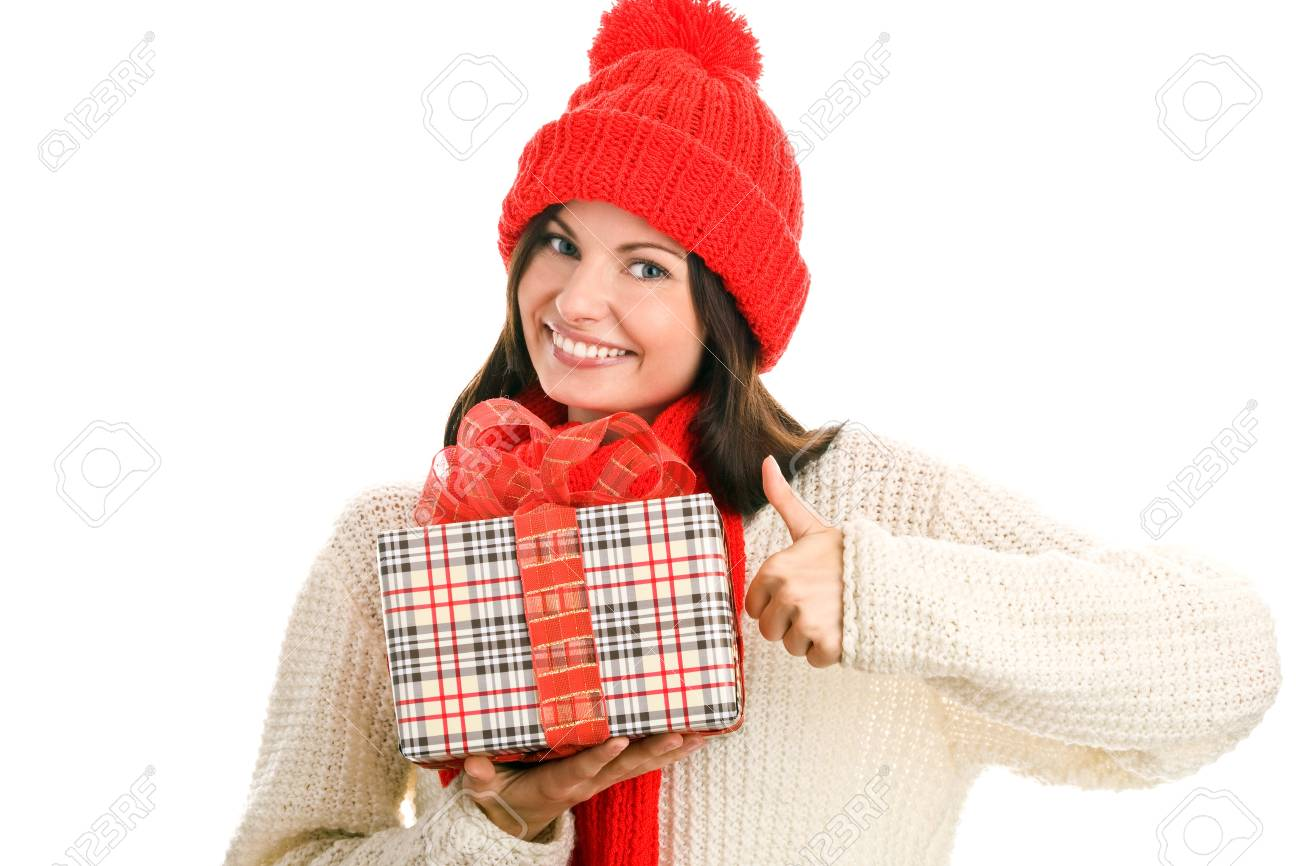 Pretty young woman with gift giving thumbs up Stock Photo - 8367247