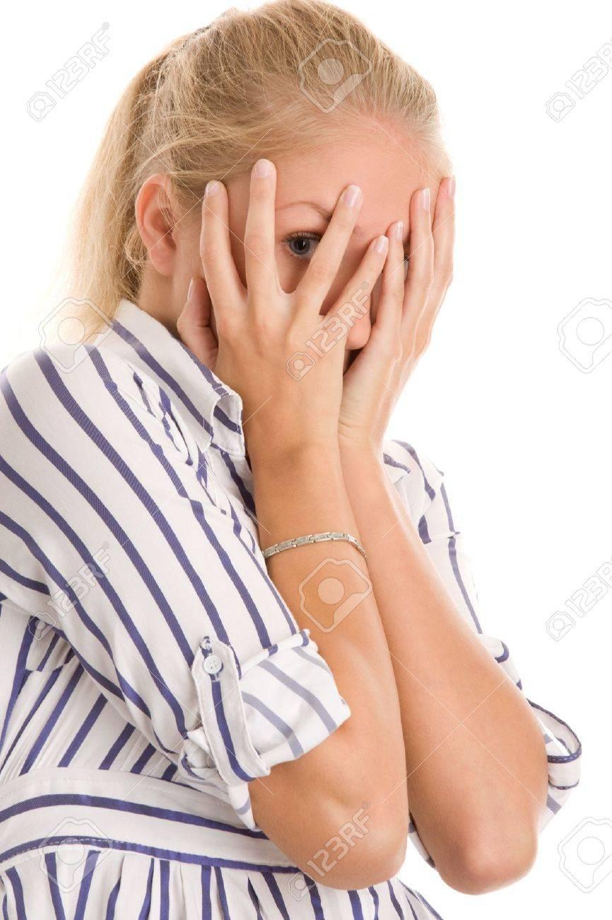 Woman peeking through fingers Stock Photo - 9423324