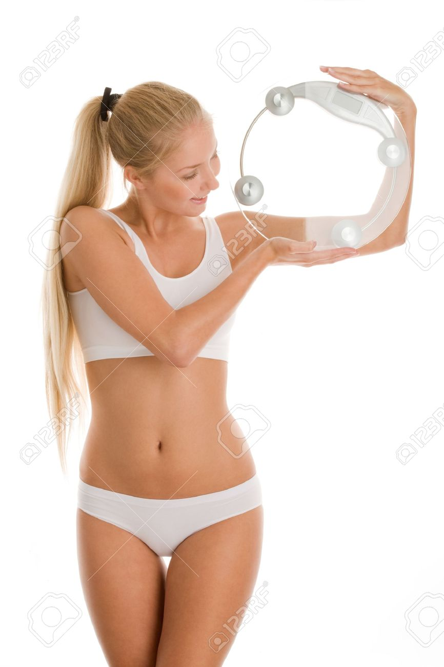 beautiful blonde woman holding bathroom scale stock photo, picture