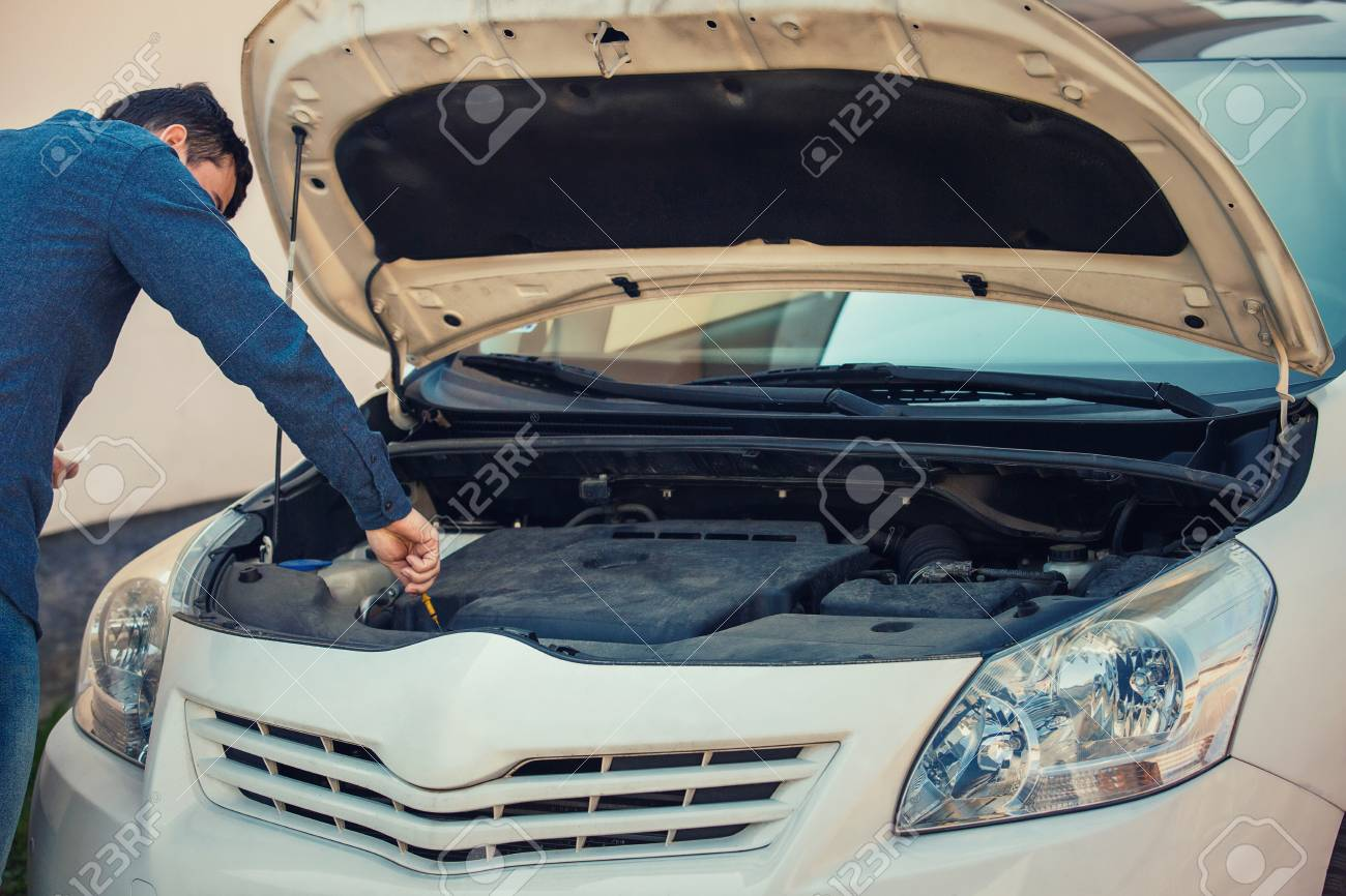 Driver check oil level in the car engine  Vehicle repair service,