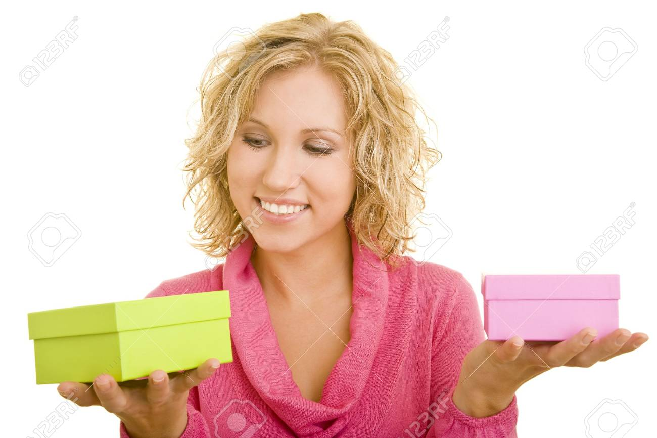 Young woman looking at two different gift boxes Stock Photo - 3793595