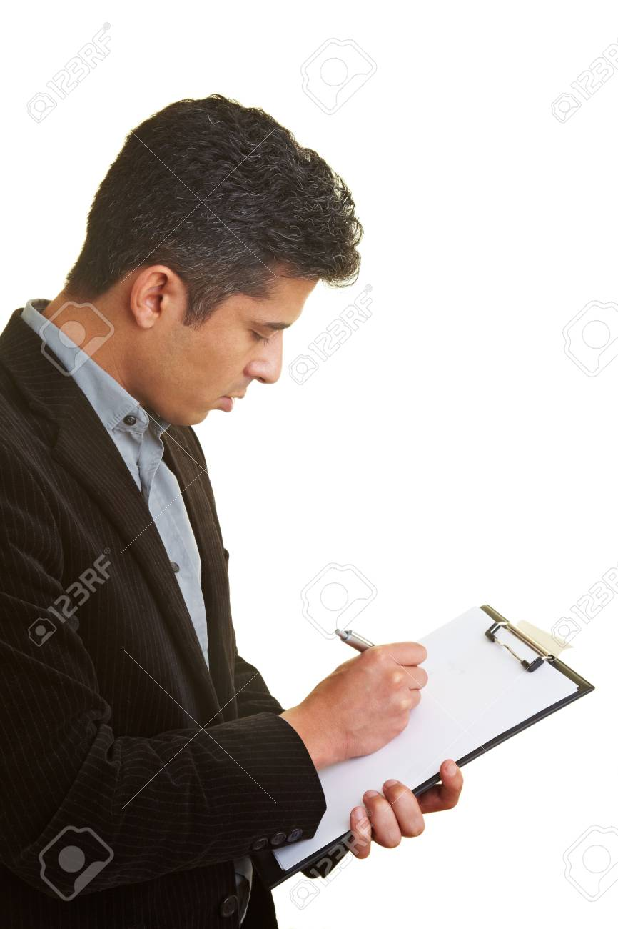 Businessman making notes on a clipboard Stock Photo - 5285630