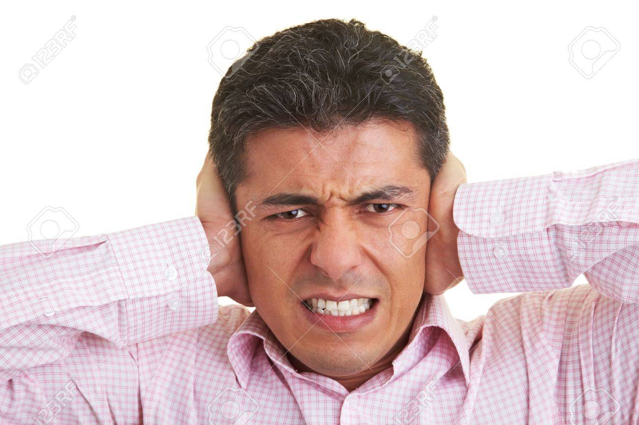 Man covering his ears with his hands Stock Photo - 5285633