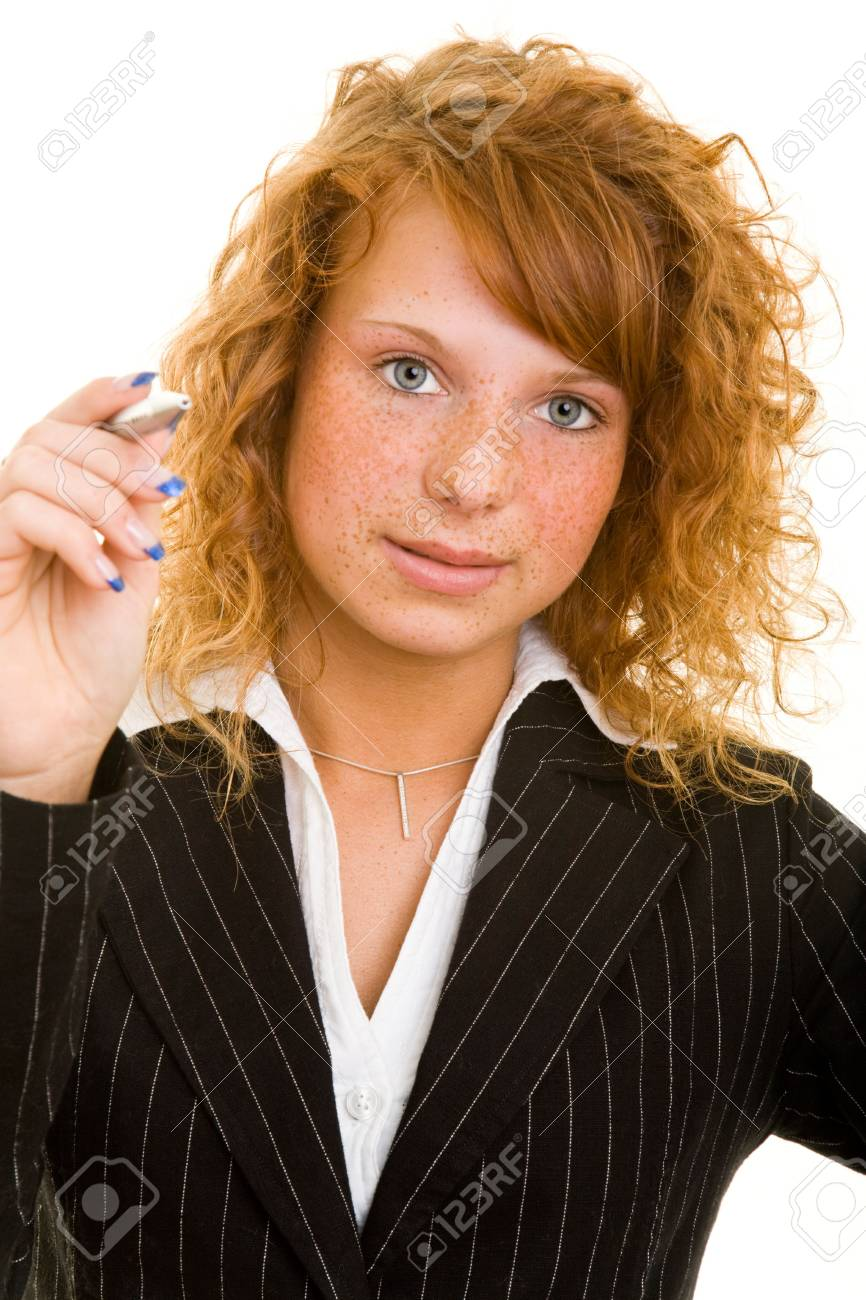 Young redhaired woman holding a ballpoint-pen Stock Photo - 5288765