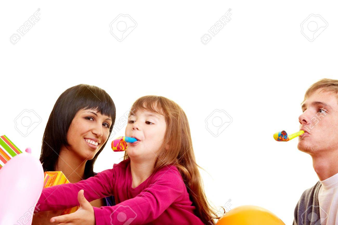 Parents celebrating a birthday with their daughter Stock Photo - 5529348