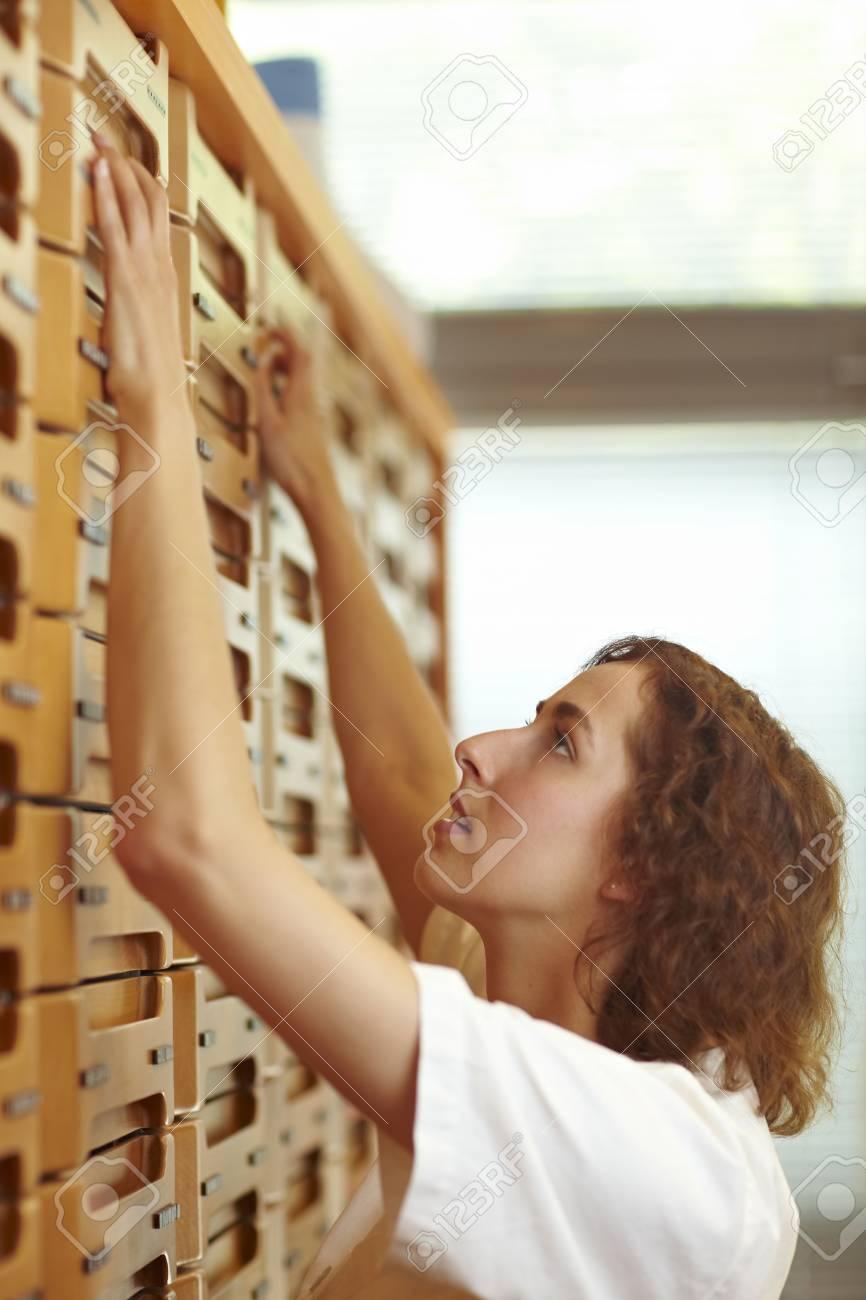 Female pharmacist at medicine cabinet in pharmacy Stock Photo - 6053535