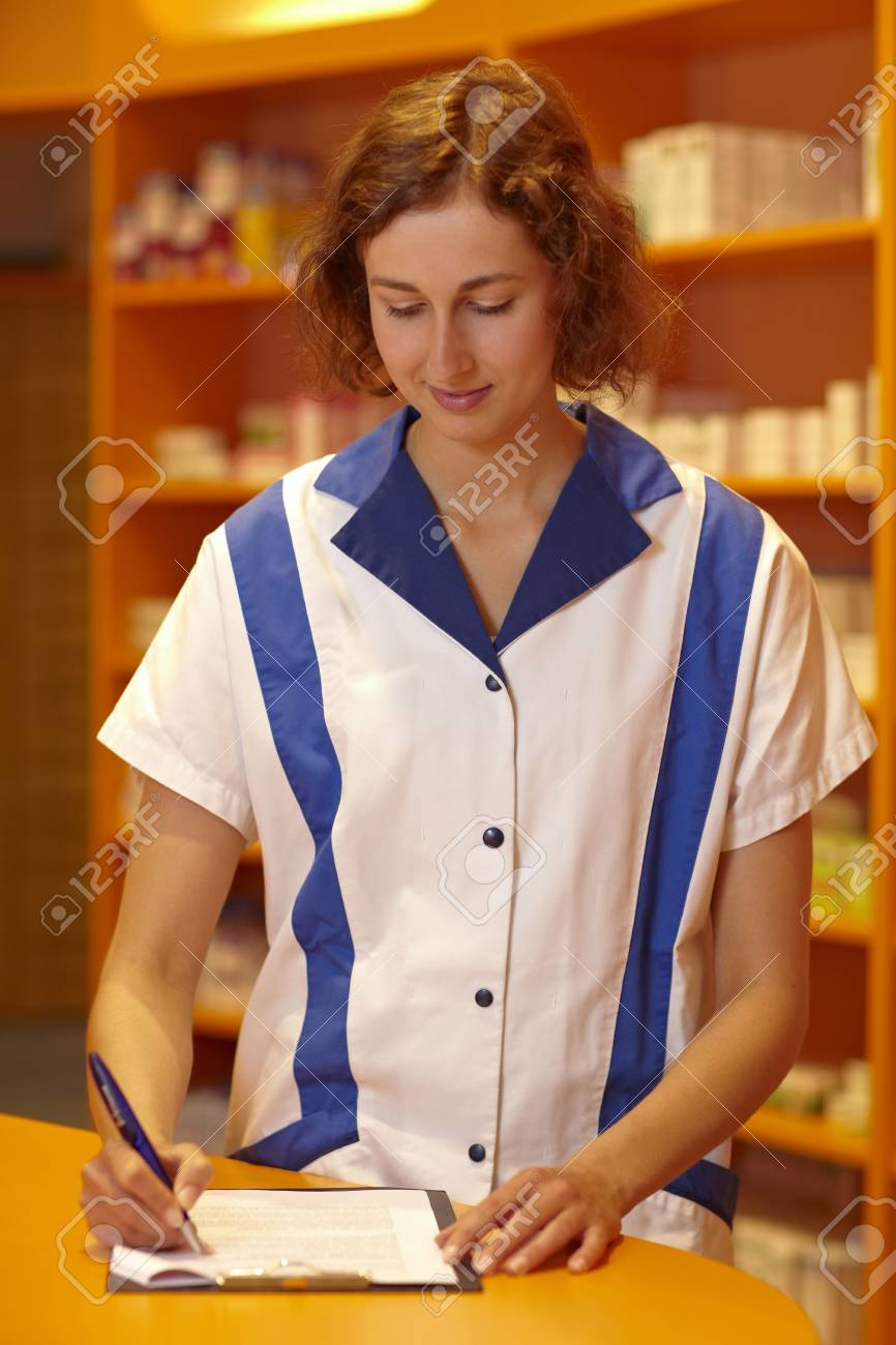 Female pharmacist filling out questionnaire in pharmacy Stock Photo - 6066806