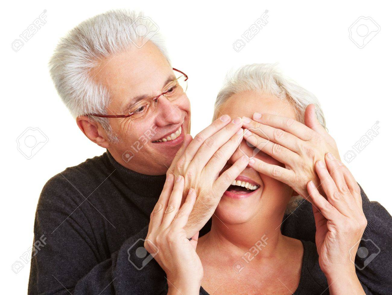 Elderly man covering the eyes of his wife Stock Photo - 6375761