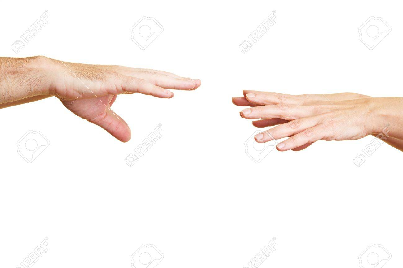 Two hands reaching for two other hands Stock Photo - 6375708