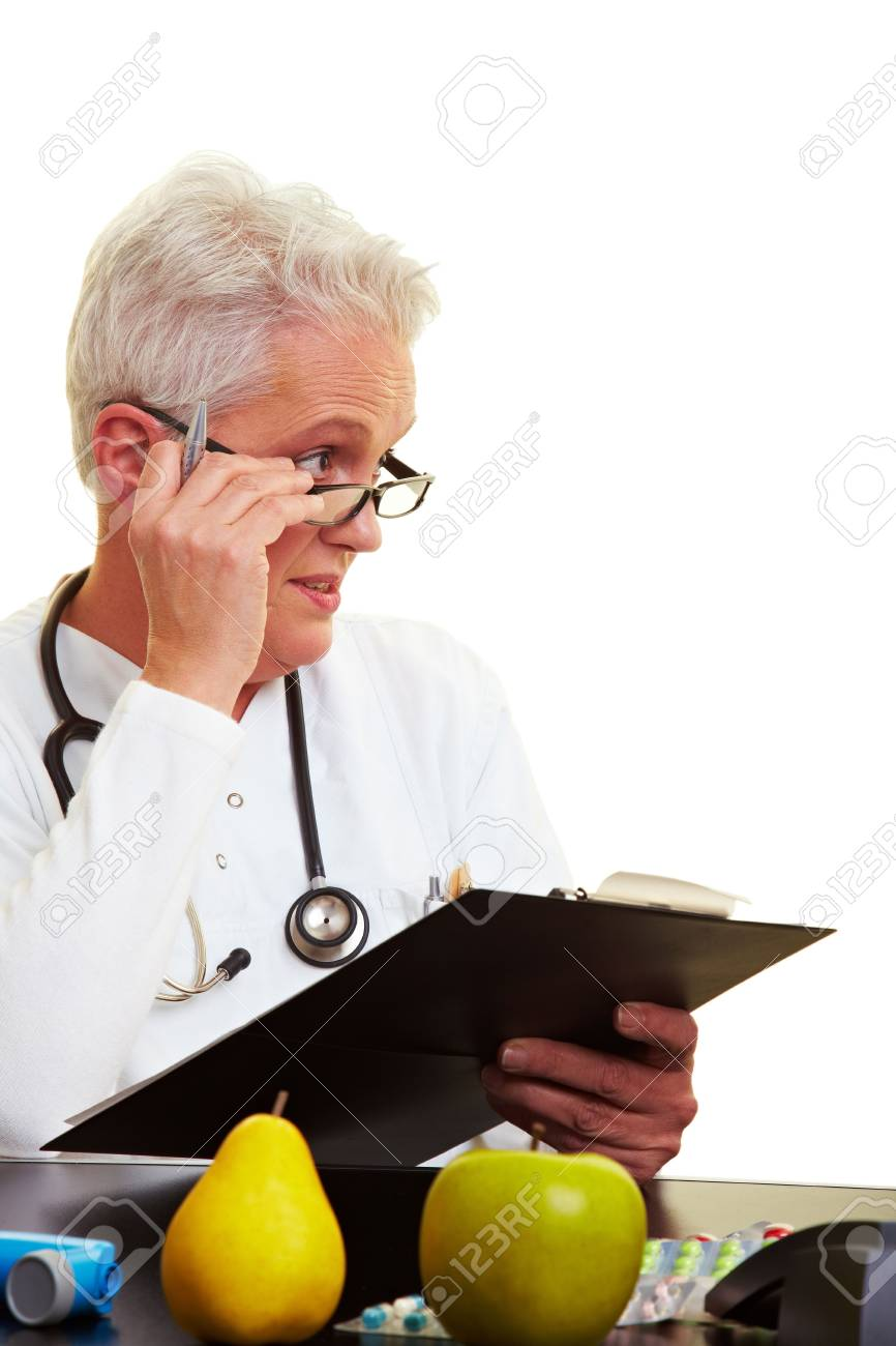 Female doctor looking sceptically over her glasses Stock Photo - 6397997