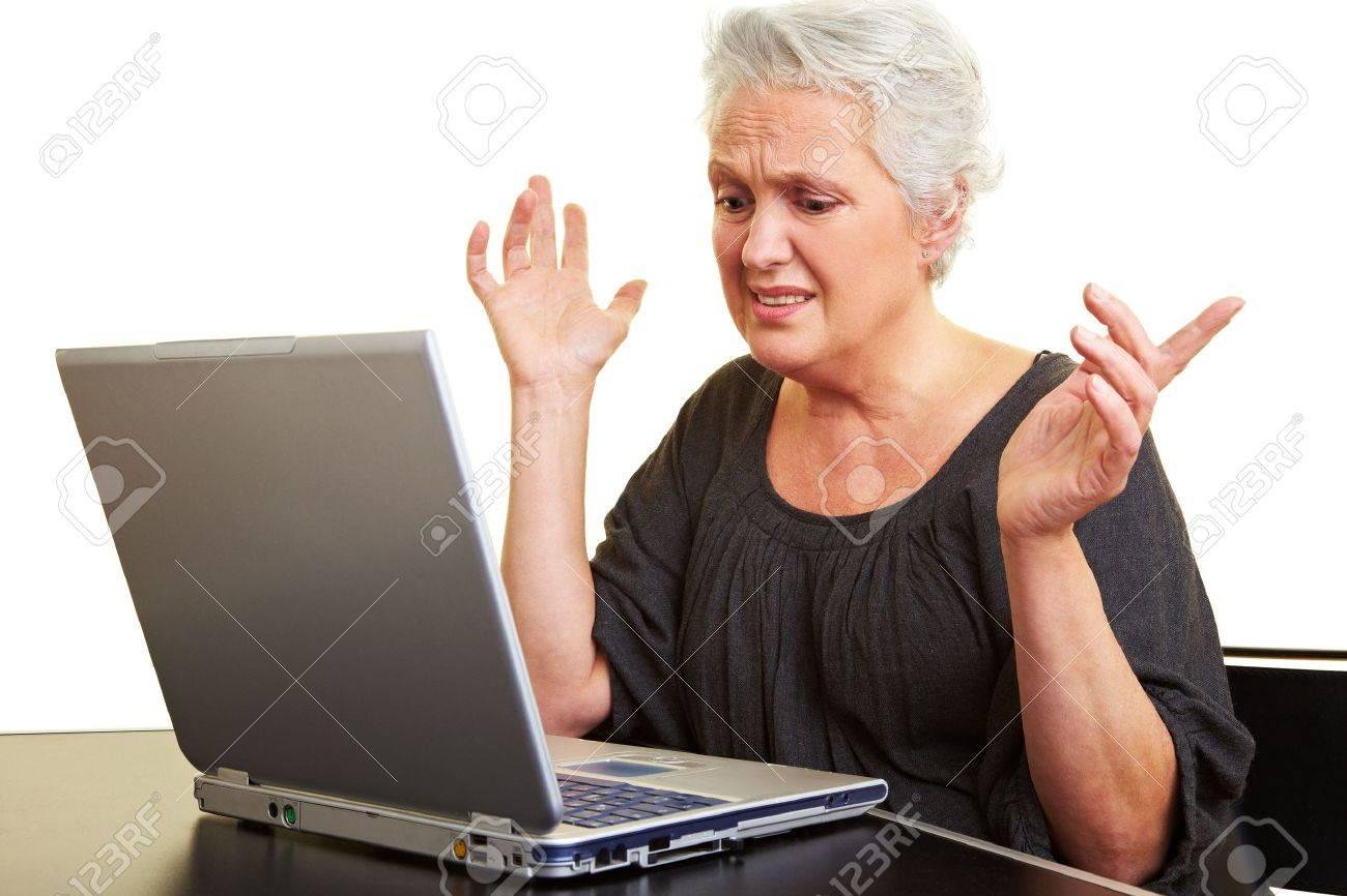A senior woman working on a laptop Stock Photo - 6398094