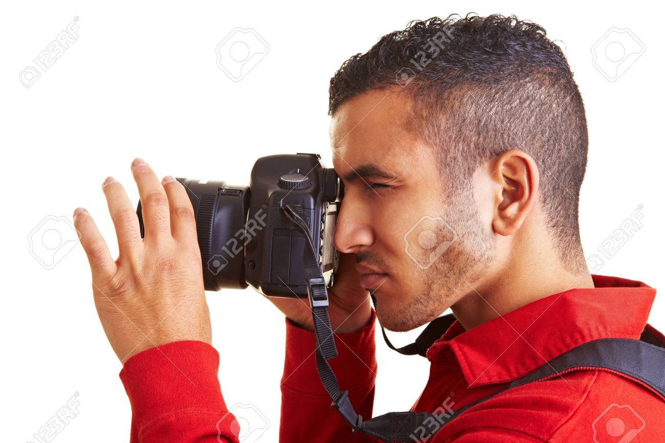 Young man looking through viewfinder of digital camera Stock Photo - 6408942