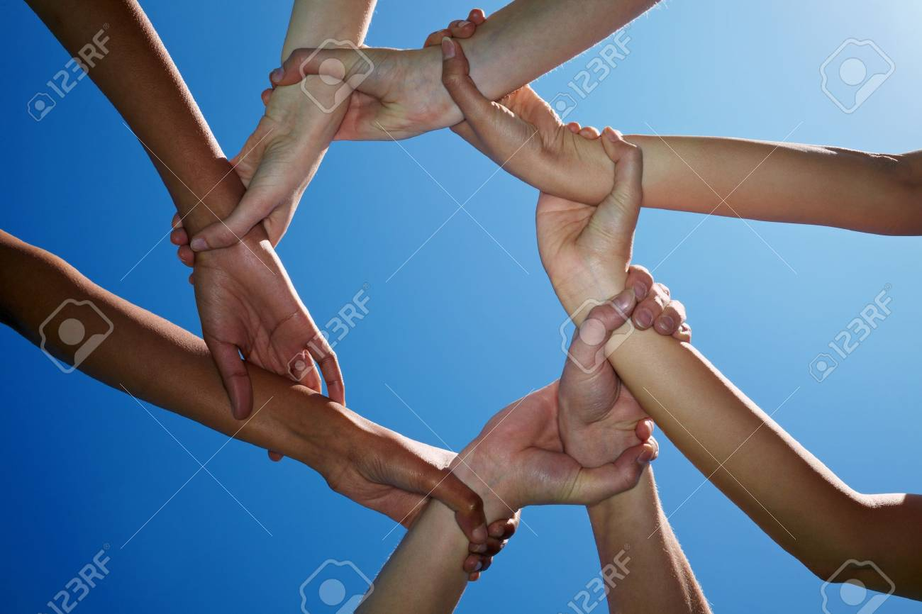 Four people holding each other on the wrists Stock Photo - 7222706