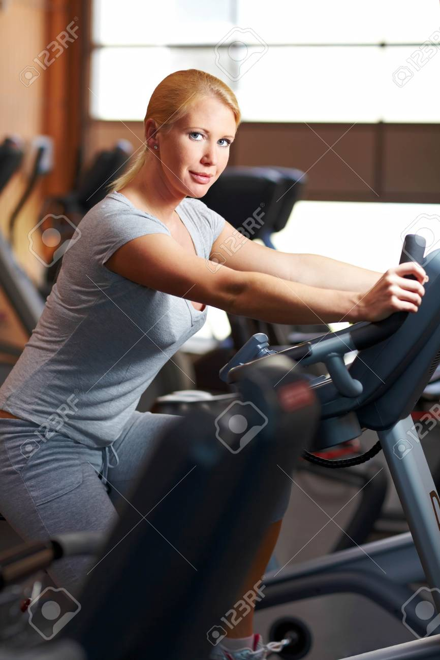 Woman in a gym using a home trainer Stock Photo - 7940549