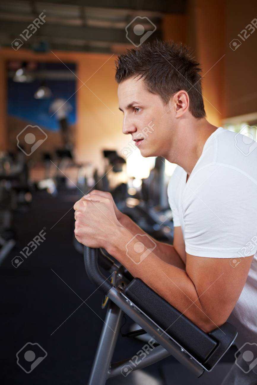 Young man working out in a gym Stock Photo - 8128590