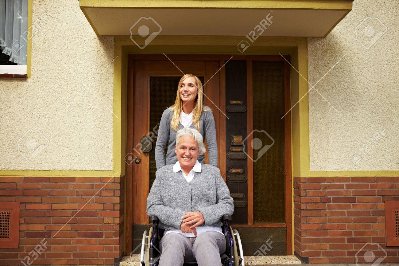Smiling elderly woman in front of a retirement home Stock Photo - 8291607