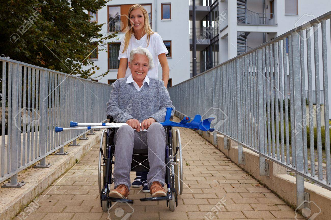 Happy woman in wheelchair on a ramp Stock Photo - 8291708