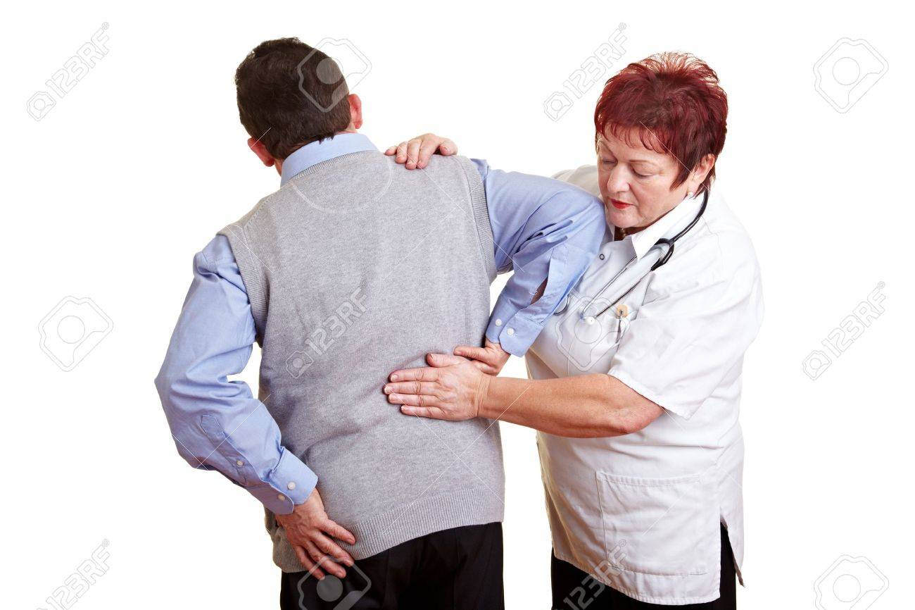 Man with back problems seeing a female doctor Stock Photo - 8597882