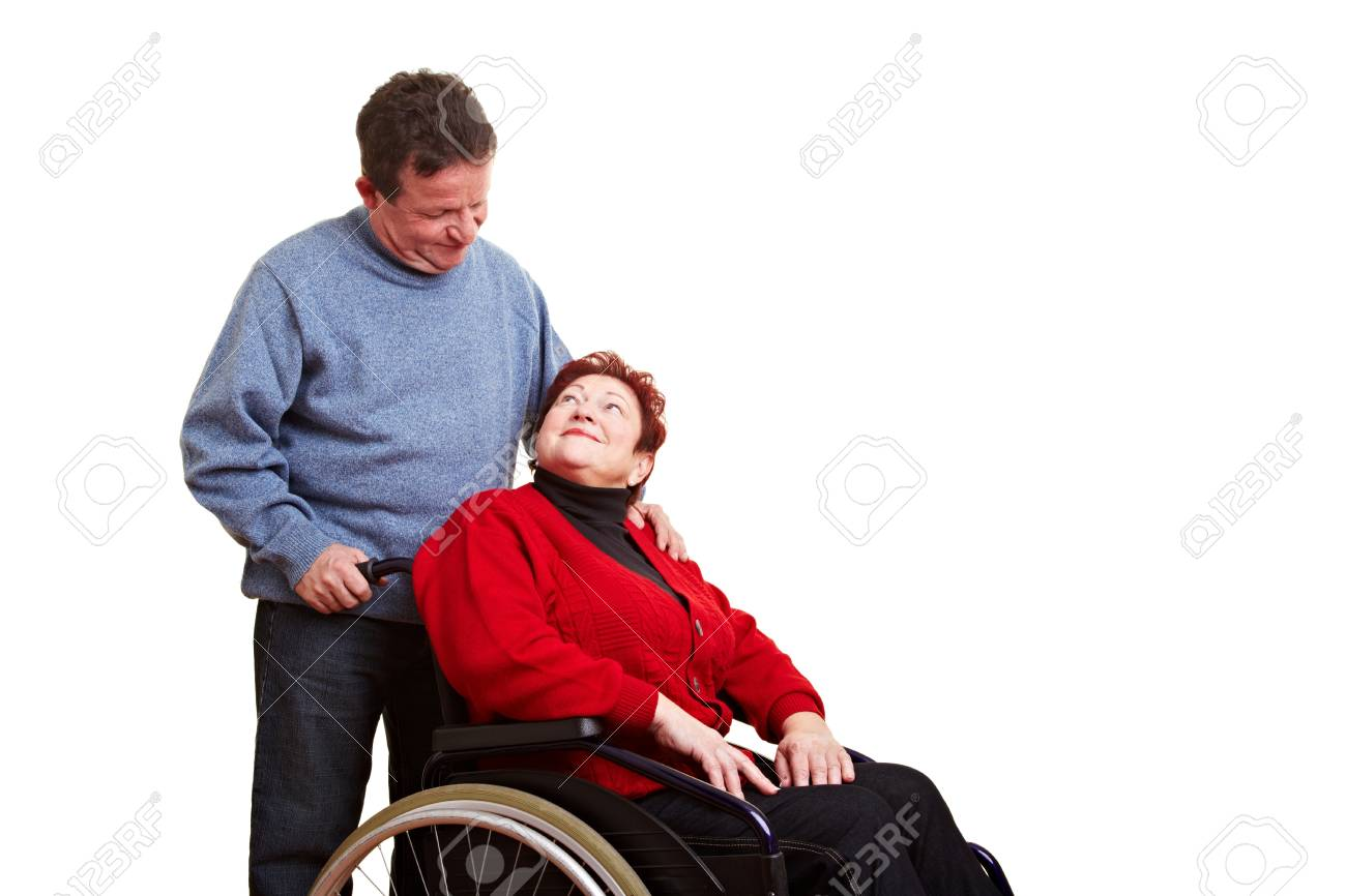 Male nurse caring for disabled senior woman in wheelchair Stock Photo - 8597756