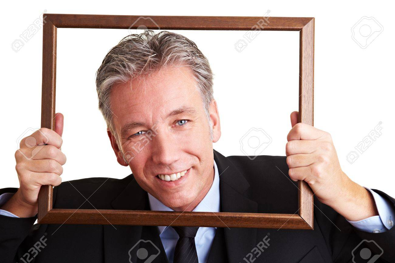 Smiling senior business man looking through an empty frame Stock Photo - 8903662