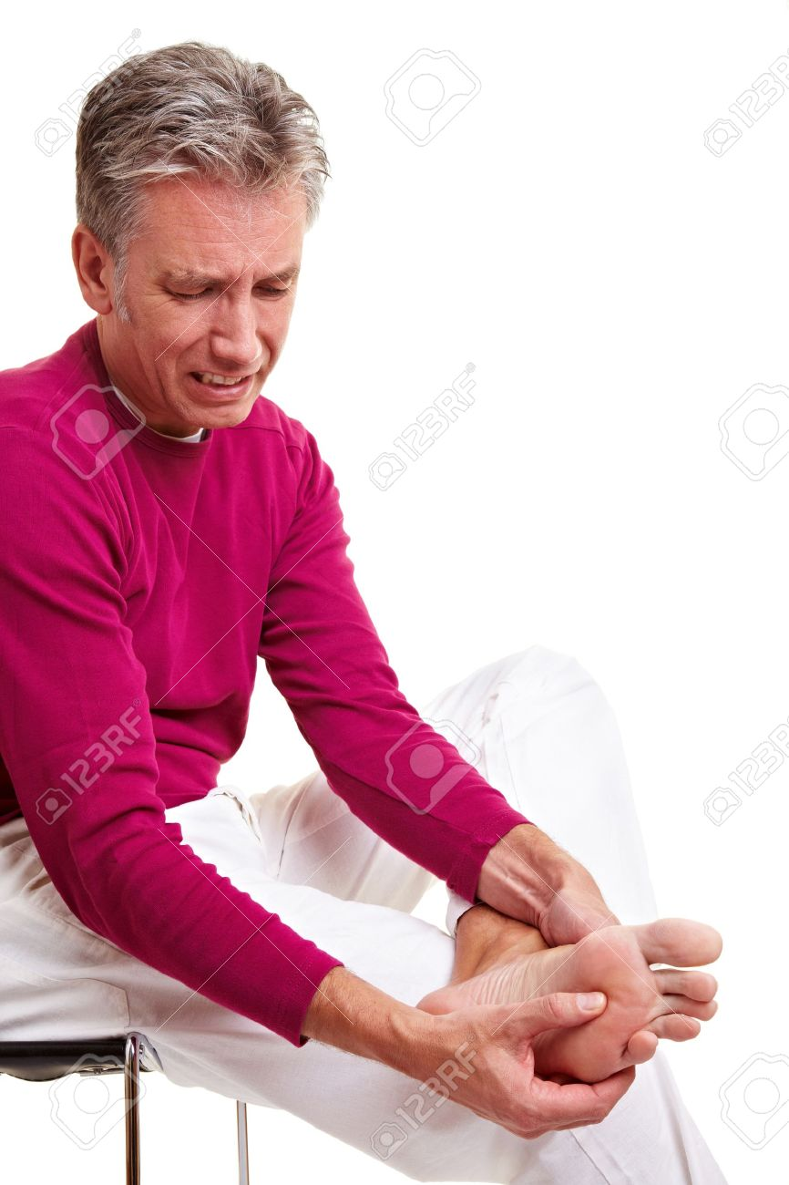 Senior man with foot pain massaging his feet Stock Photo - 8953291