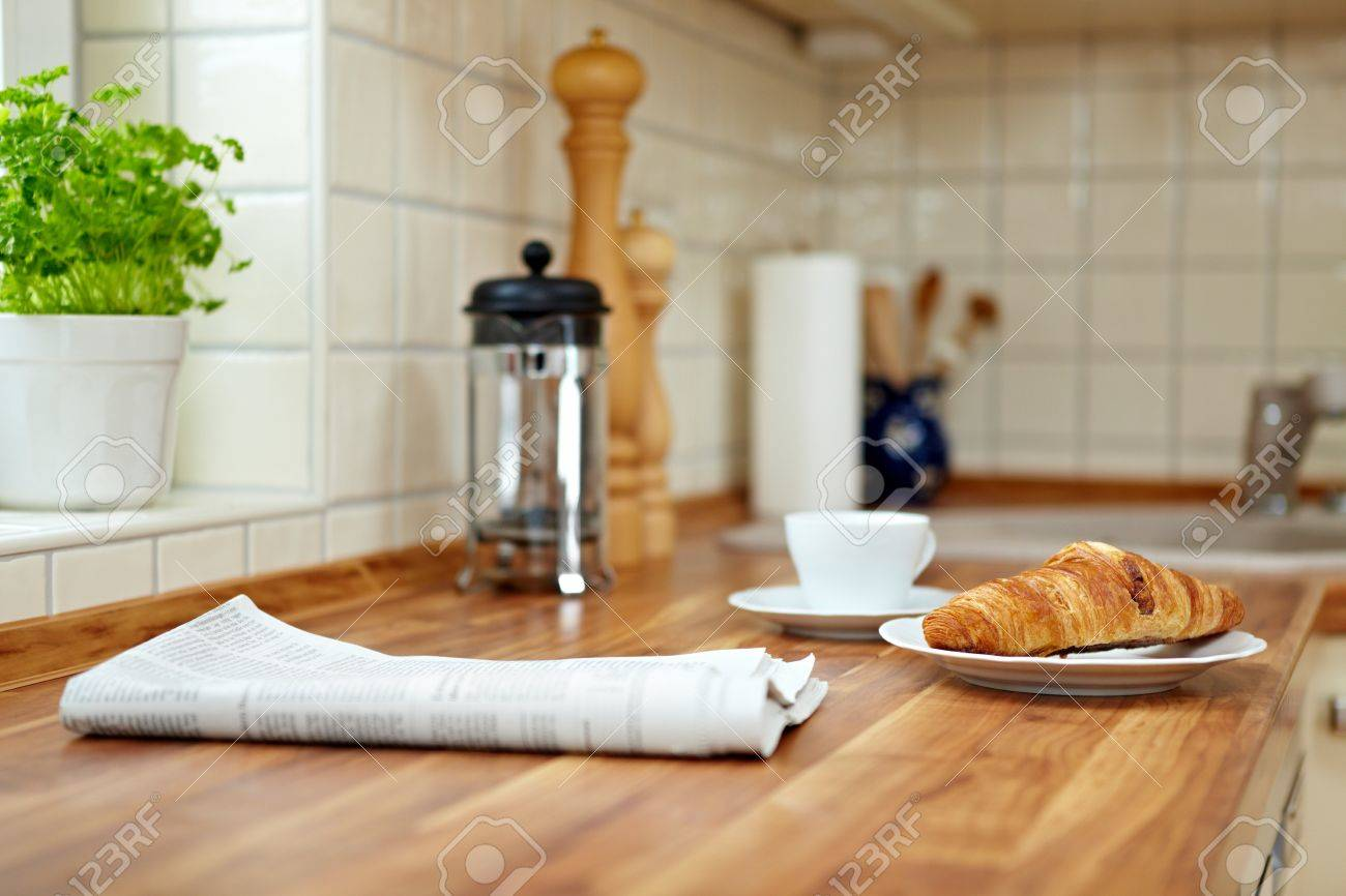 Kitchen Top Croissant And A Cup Of Coffee On A Kitchen Counter Stock Photo