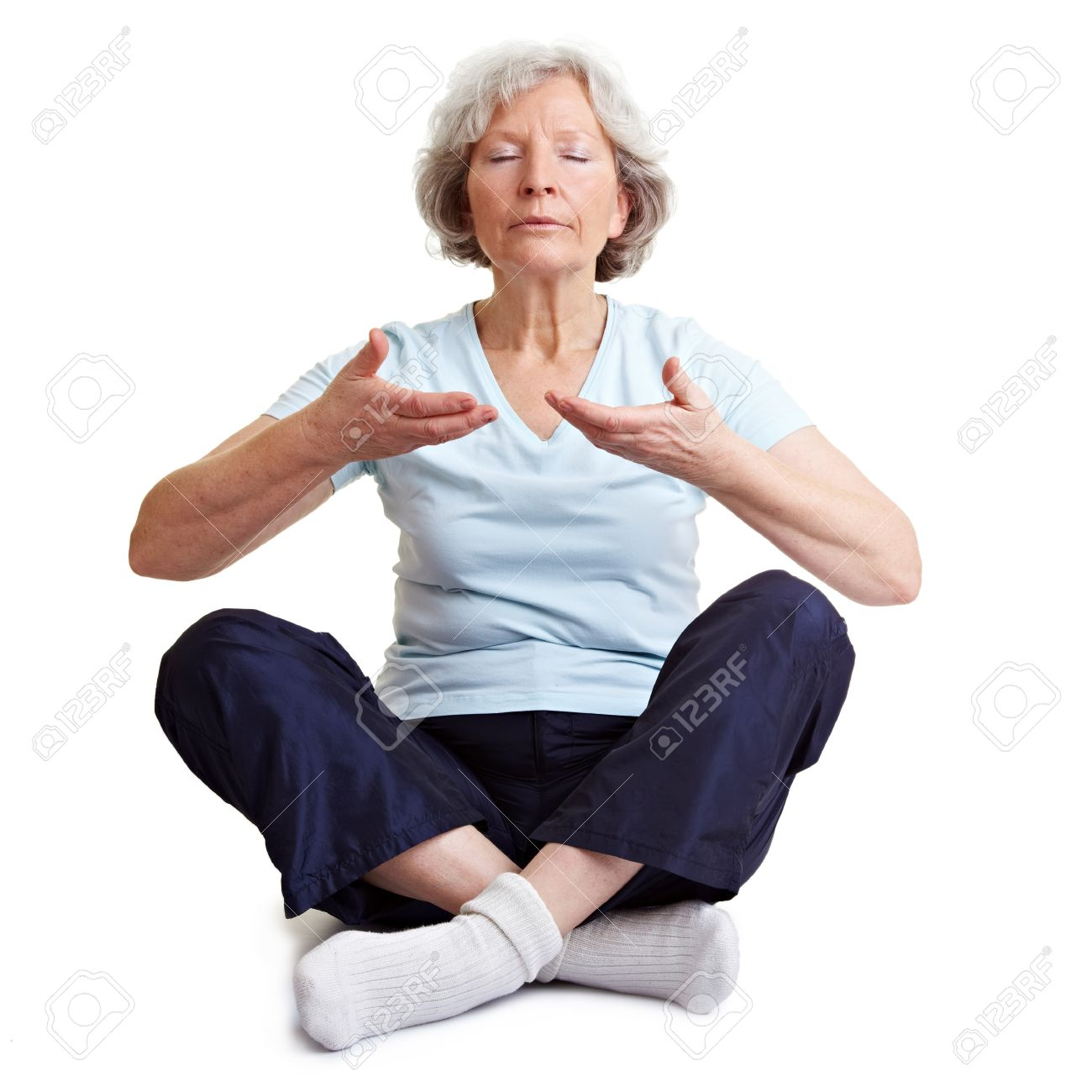 Old senior woman meditating and relaxing with breathing exercises Stock Photo - 9108629