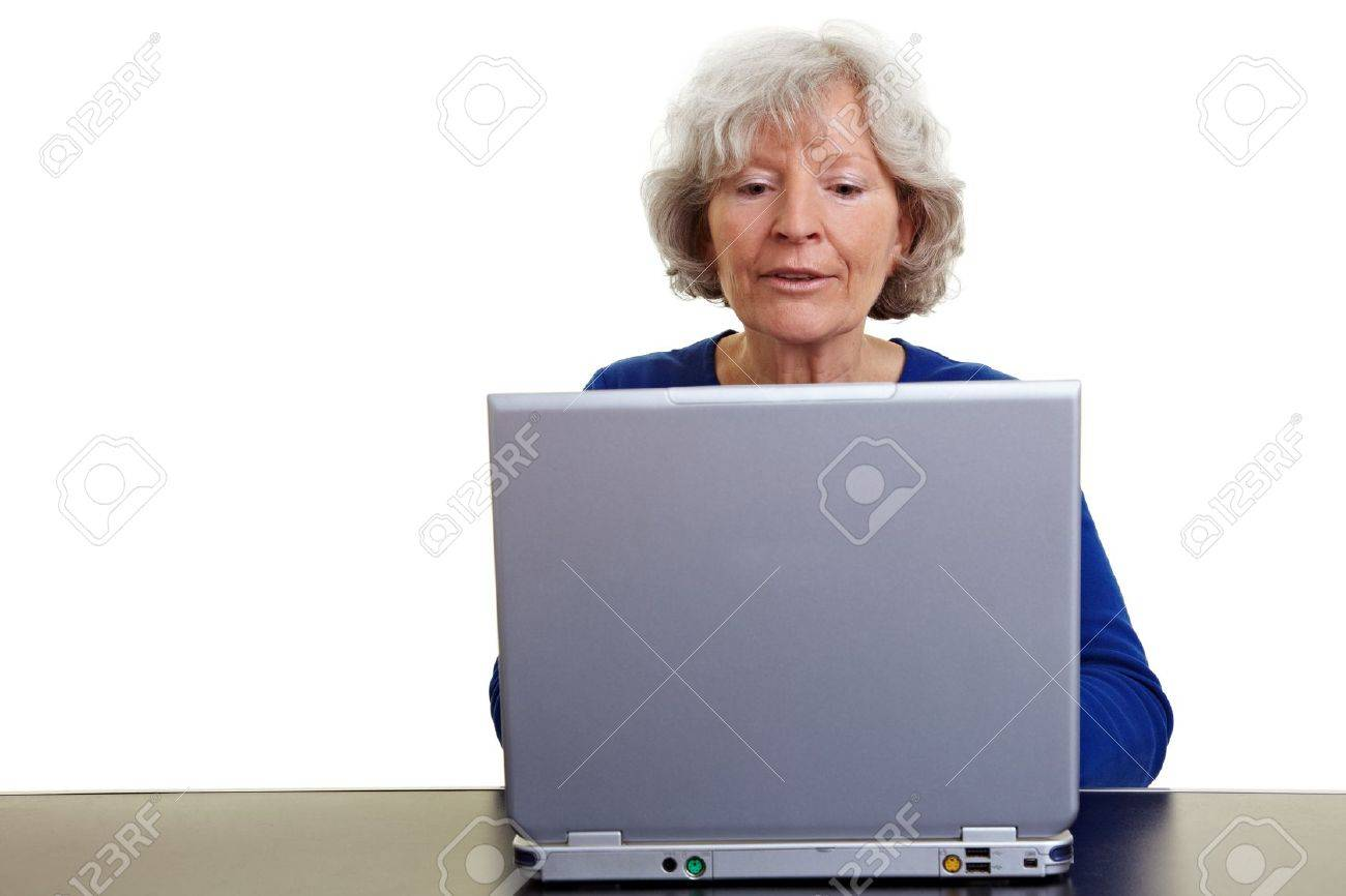 Happy senior woman working on a laptop Stock Photo - 9108636