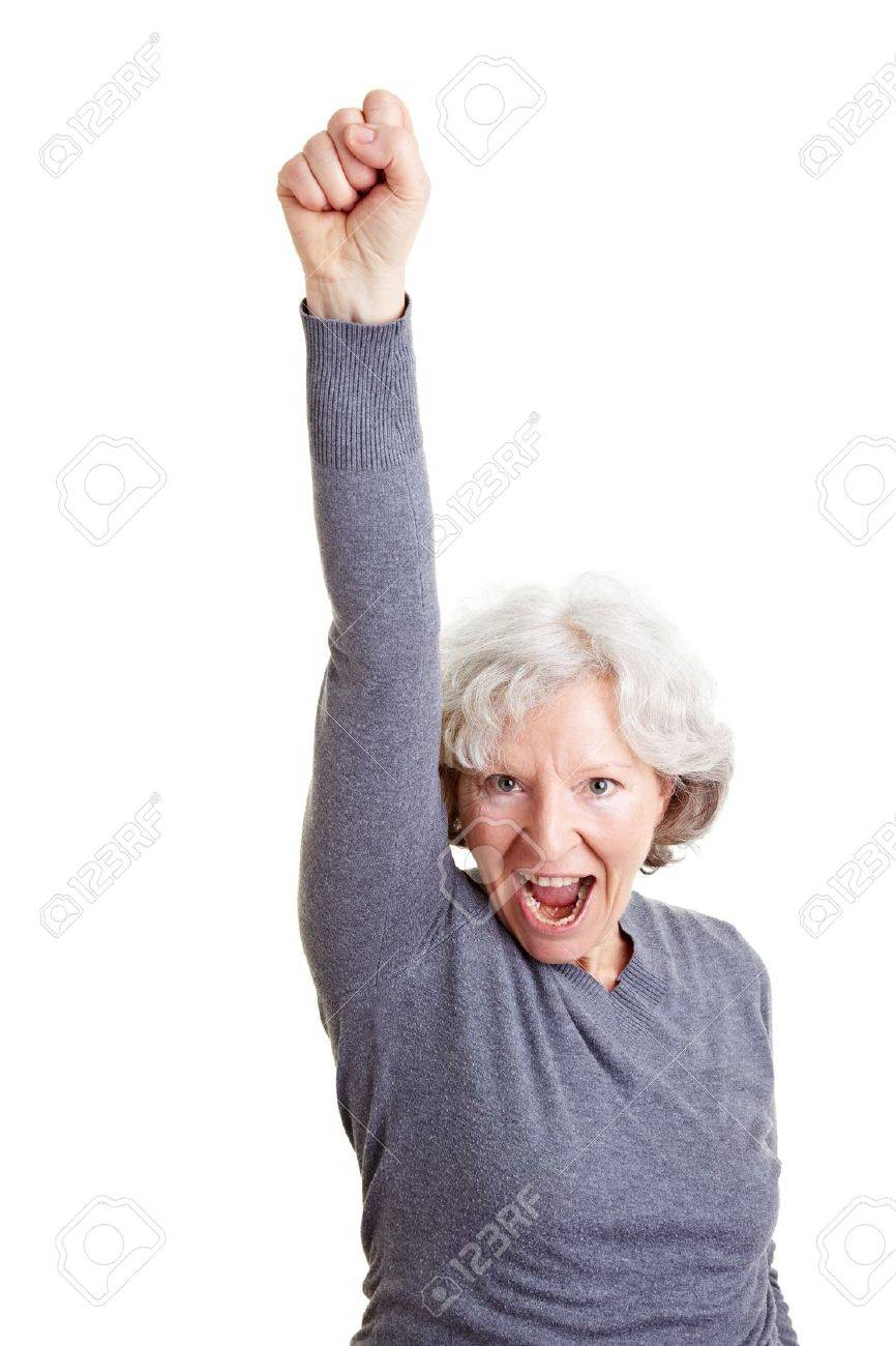 Cheering old senior woman clenching her fist Stock Photo - 9115028