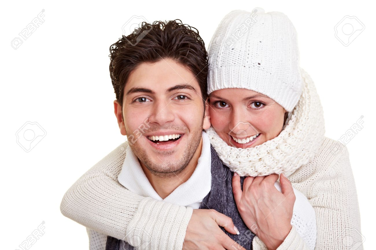 Young happy attractive couple in winter clothing Stock Photo - 9323011