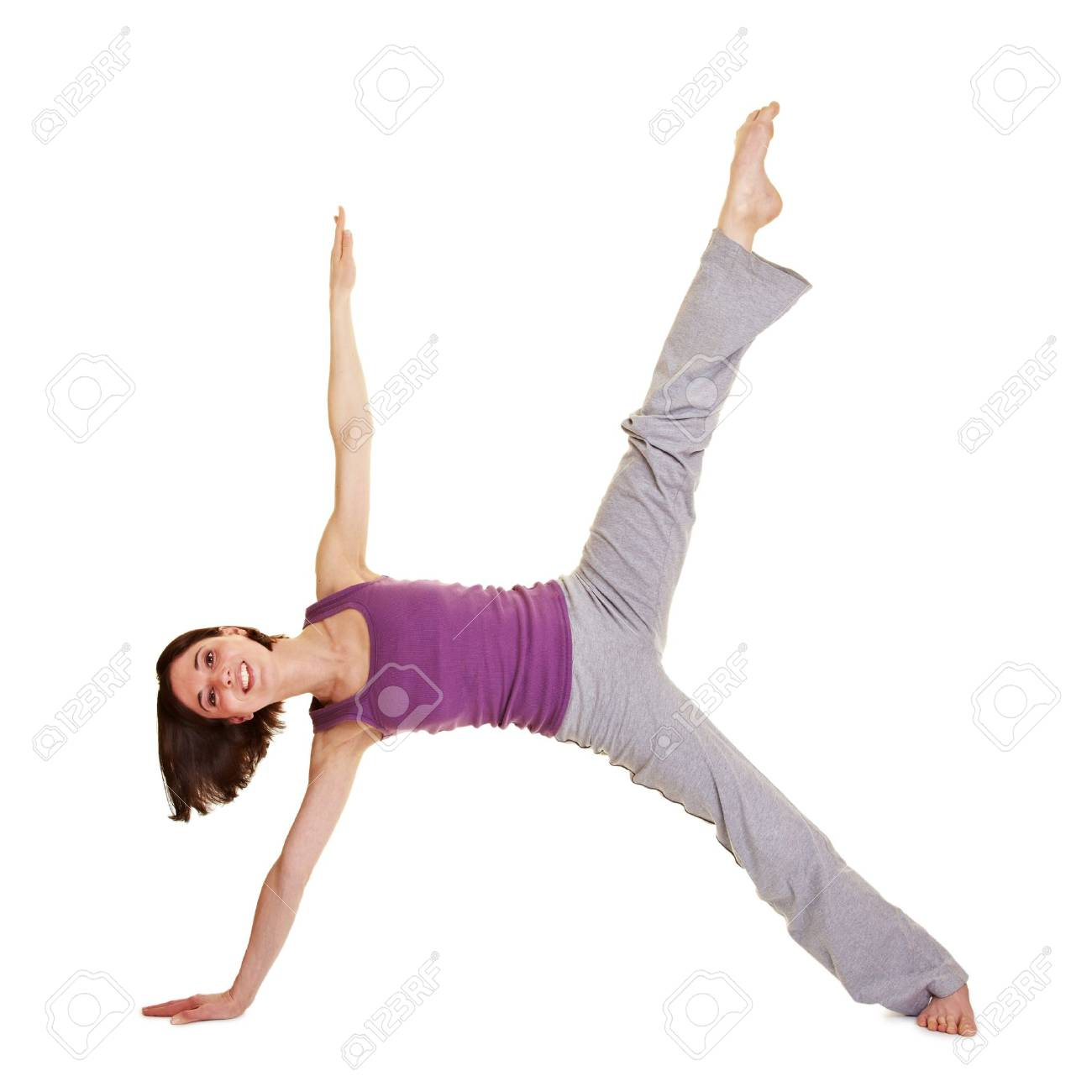 Young smiling flexible woman stretching her legs Stock Photo - 9515506