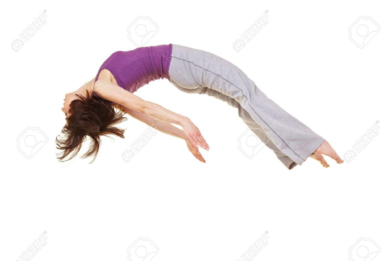 Young flexible woman doing a somersault backflip Stock Photo - 9515512