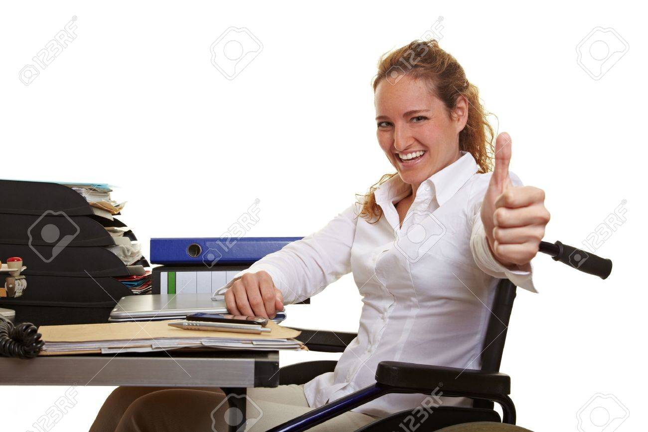 Happy disabled business woman in wheelchair holding thumbs up Stock Photo - 10174991