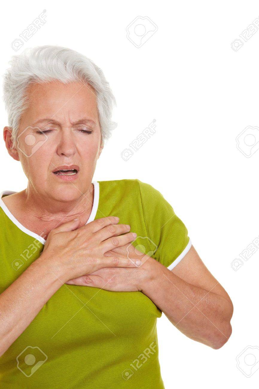 Senior woman having a heart attack and grabbing her chest Stock Photo - 10560568