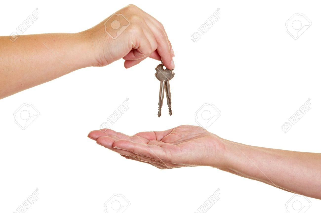 Handover Of Keys From One Hand To Another Stock Photo Picture And
