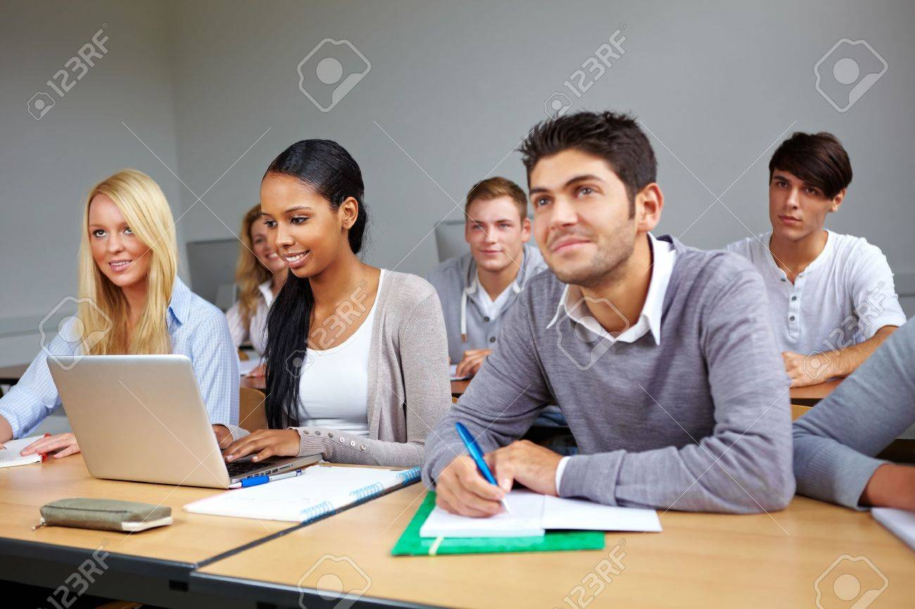Many students listening in a university class Stock Photo - 10706034