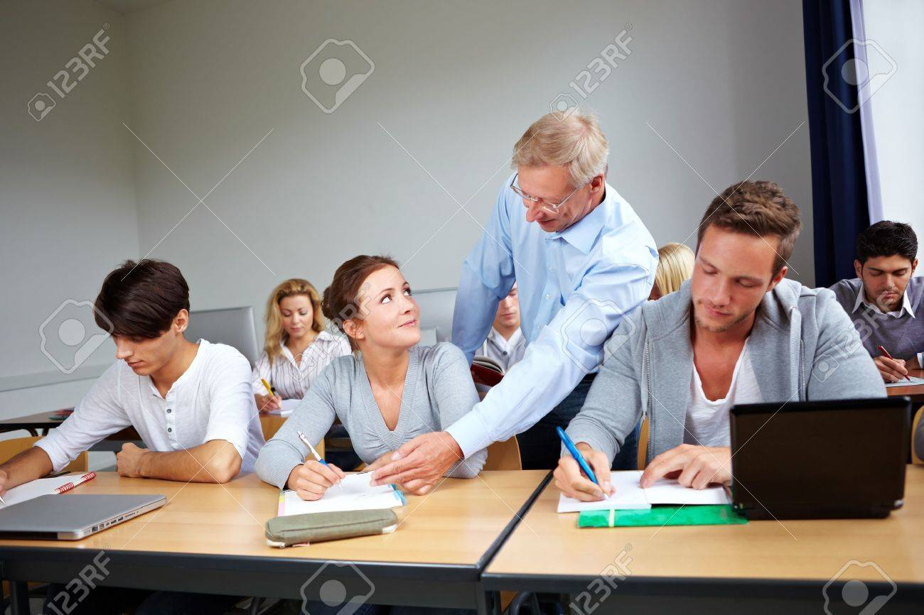 Assistance Of Students At University With A Teacher Stock Photo ...