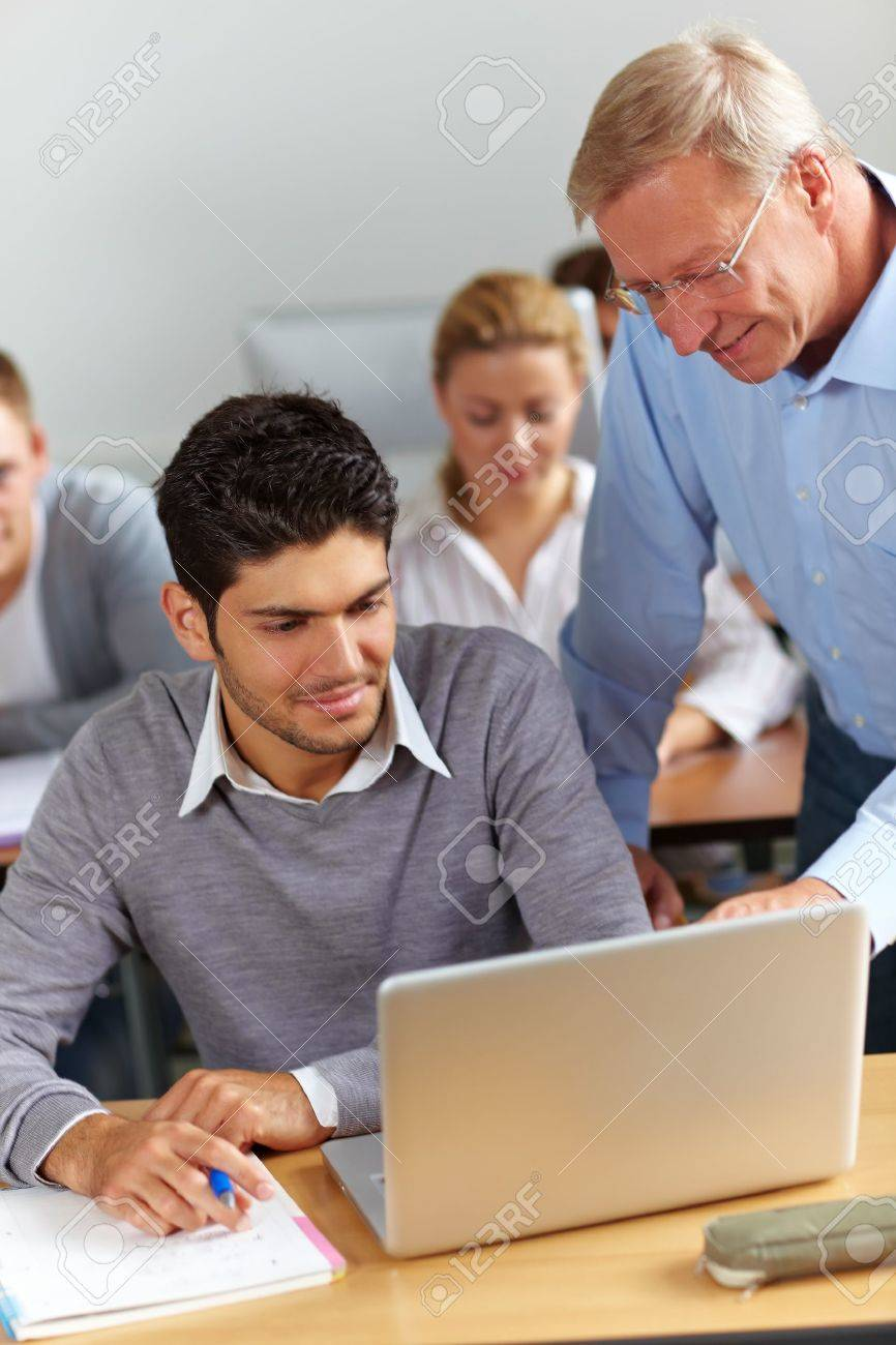 Assistance for student from teacher in university Stock Photo - 10762992