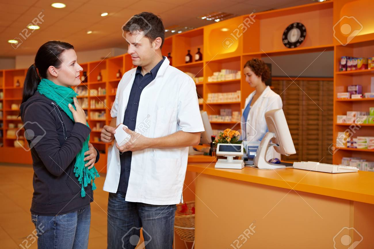 Female customer with cold gets advice from pharmacist in pharmacy Stock Photo - 10971313