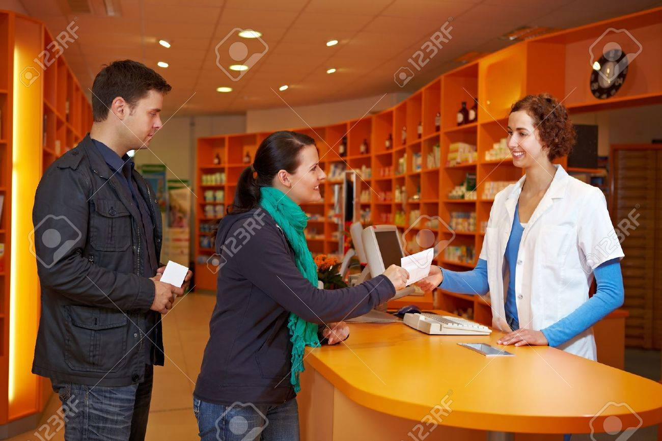 Waiting queue with customers in a pharmacy with pharmacist Stock Photo - 10971315