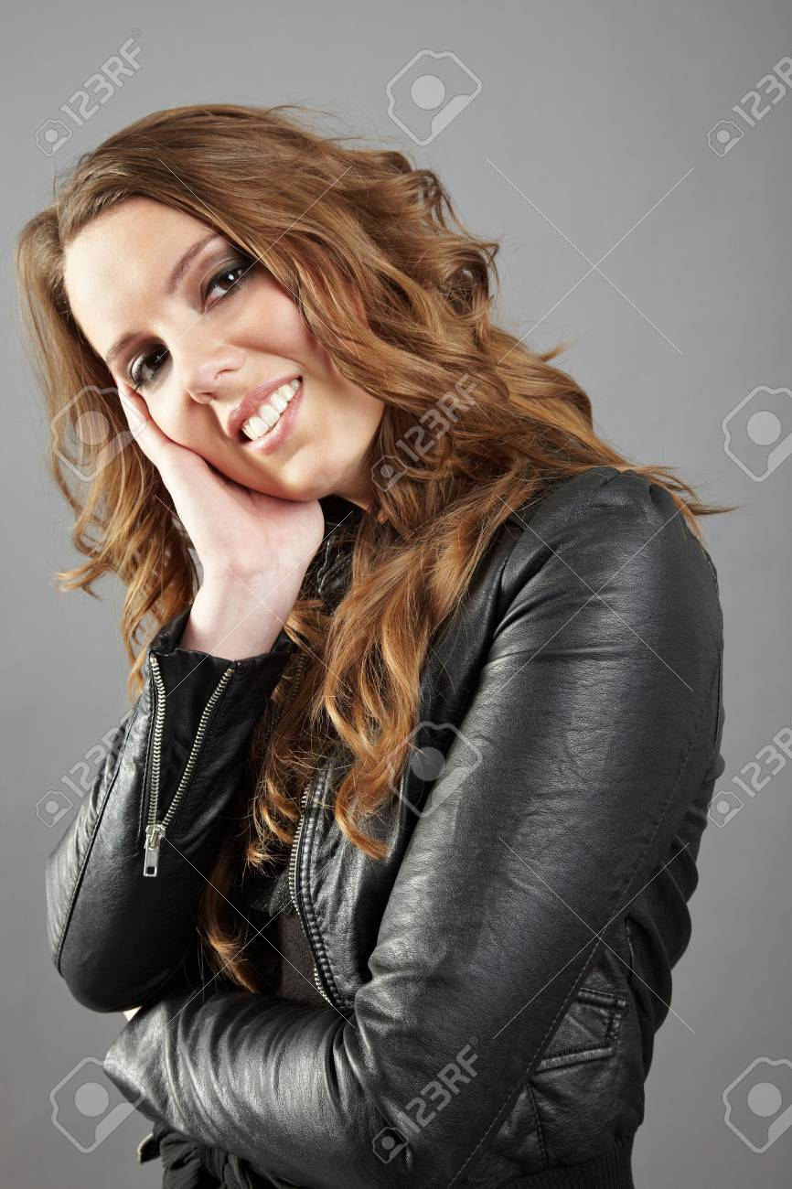 Young woman thinking with hand on her chin Stock Photo - 11396178