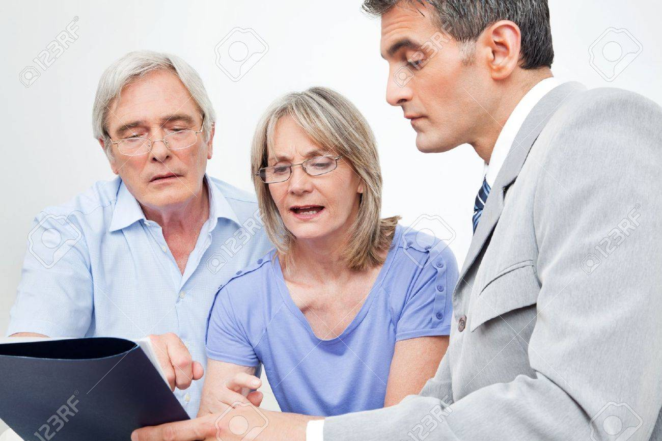 Senior couple getting financial advice from consultant at home Stock Photo - 12361477