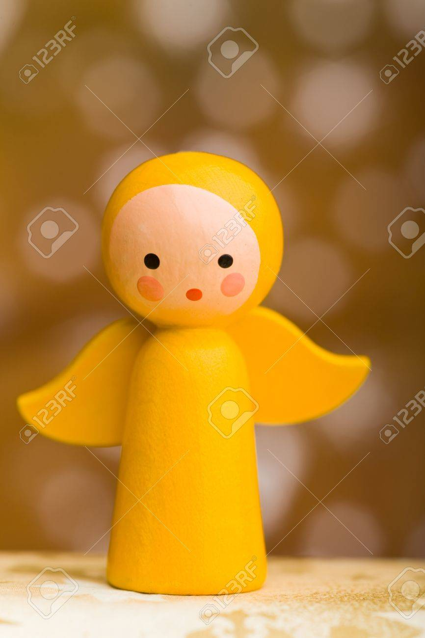 Yellow Small Wooden Christmas Angel With Wings Stock Photo, Picture ...