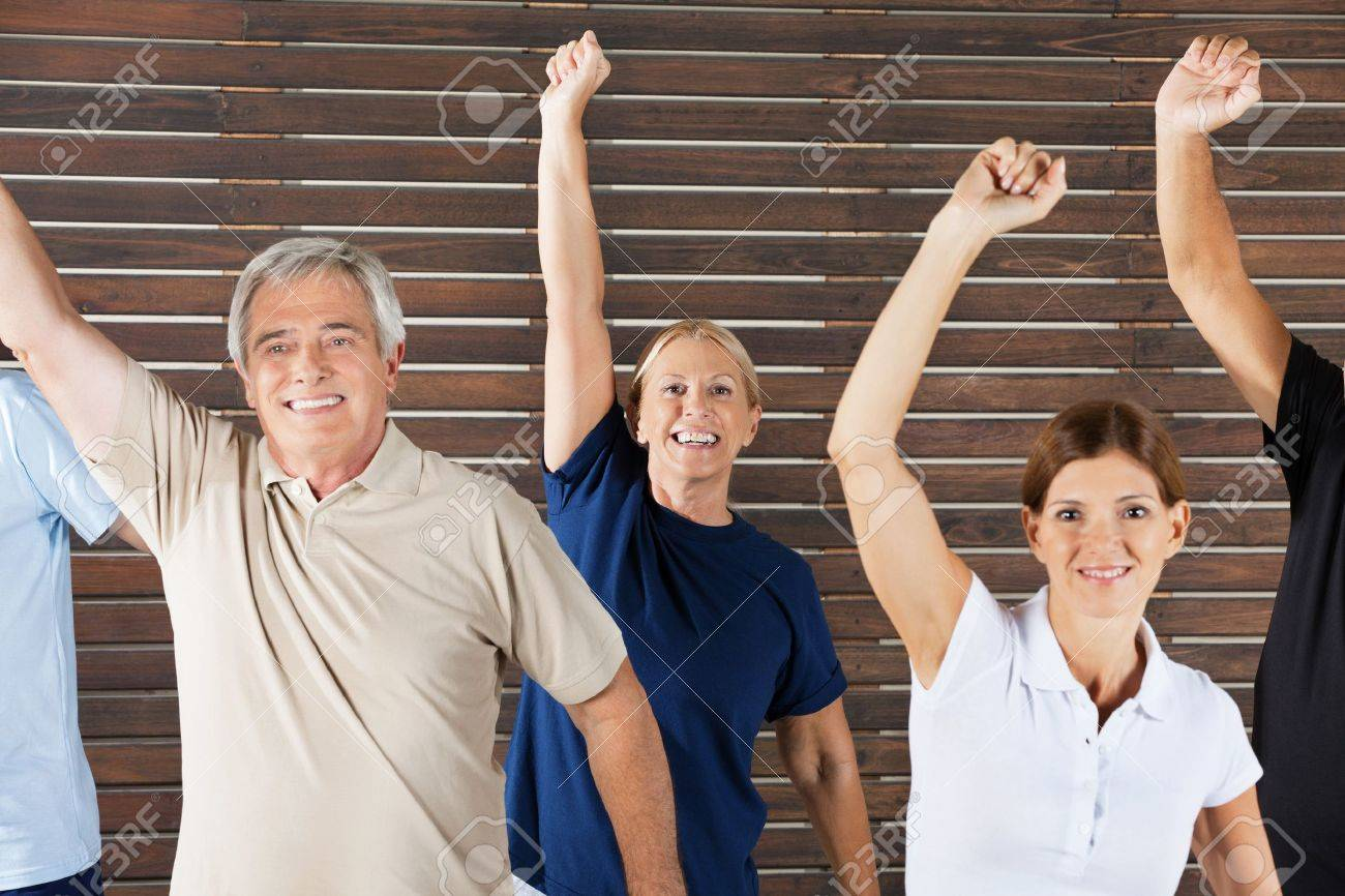 Cheering senior citizens at workout in fitness center gym Stock Photo - 12947744